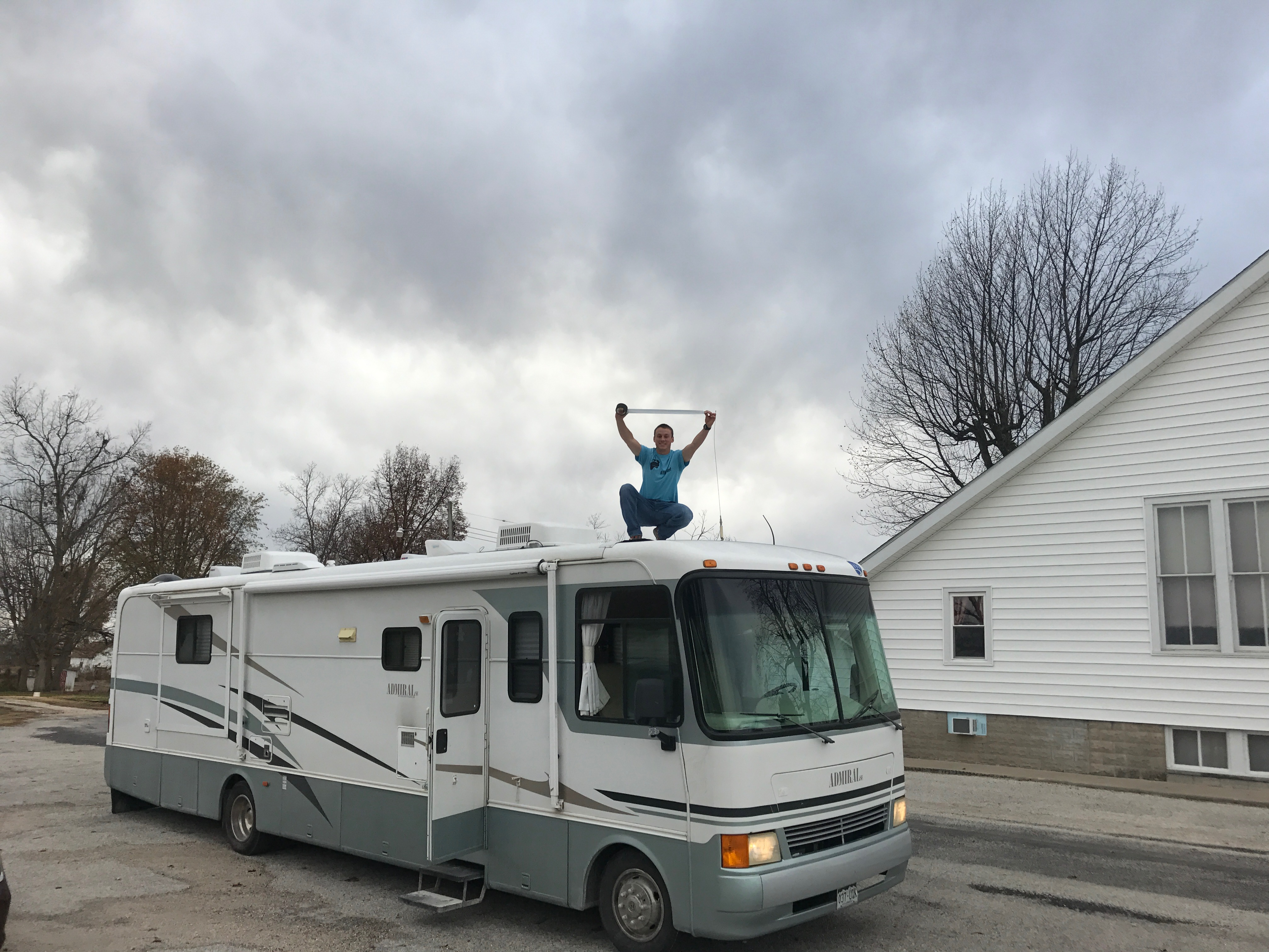 once-again-uncle-sam-doing-the-oddest-fix-it-jobs-this-time-gafer-taping-the-top-of-the-rv-before-a-long-drive_31291827822_o
