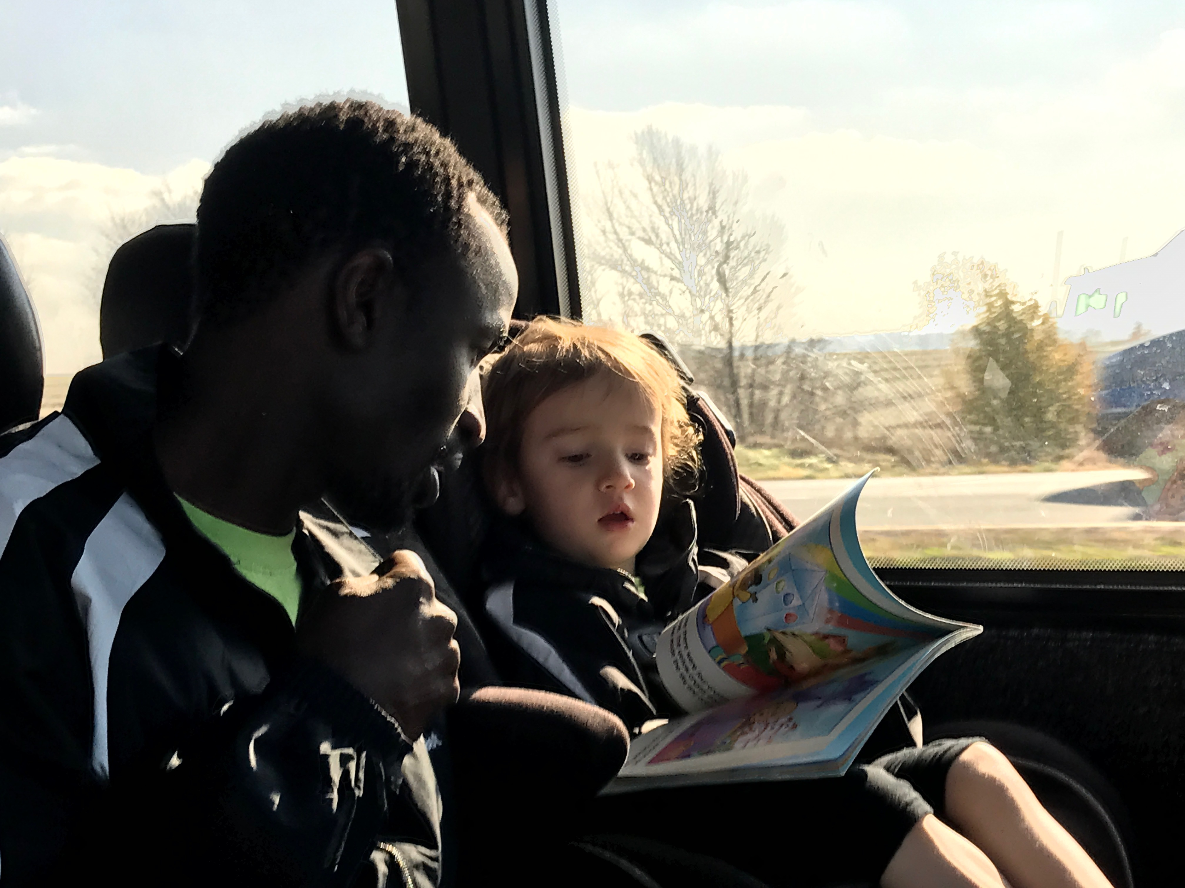 uncle-saul-reading-to-josie-on-the-bus_30628982693_o